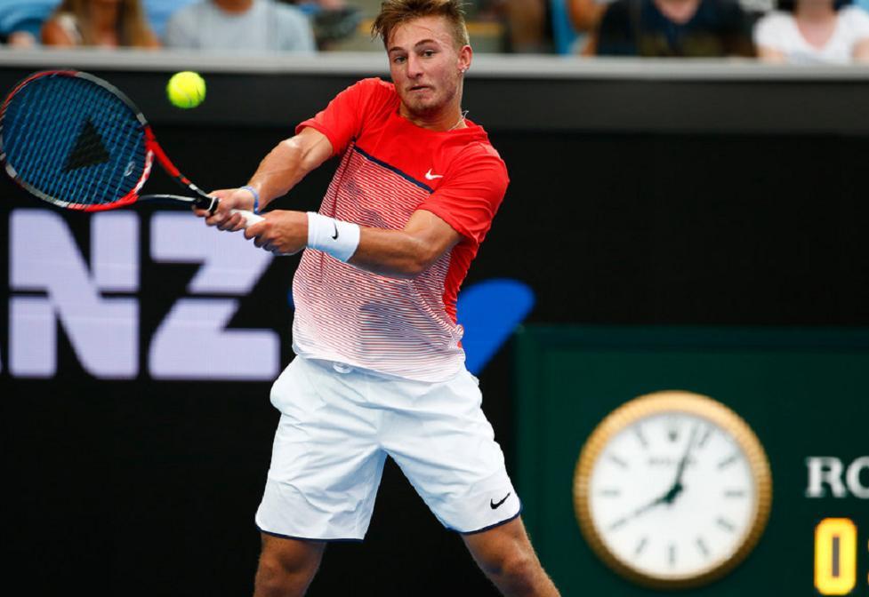rising tennis star Omar Jasika in action