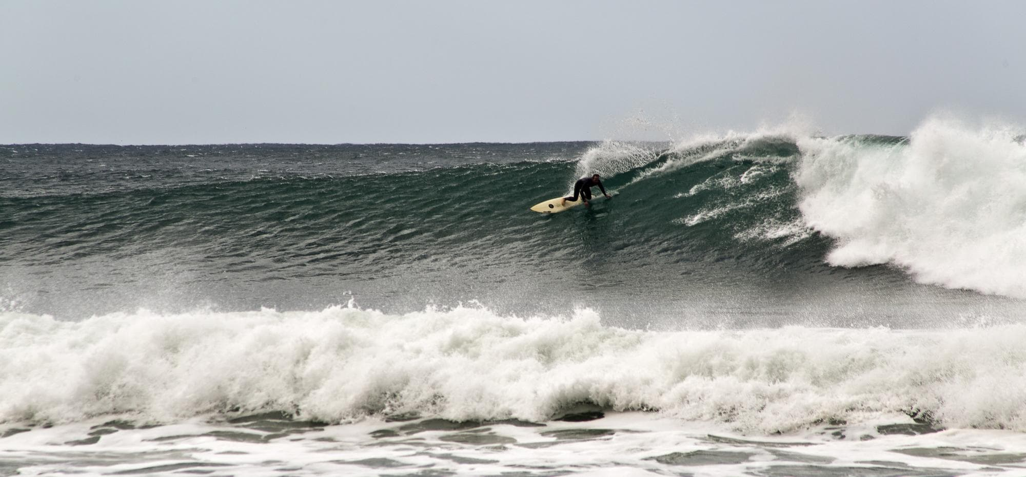Surfer on a wave at Bells Beach